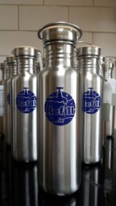 several stainless steel KleenKanteen water bottles with the refill.ie logo on them